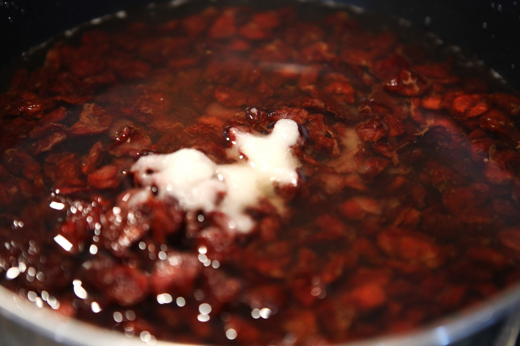 Sour cherries cooking in bourbon
