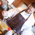 Chef Daniel Miles mixing salad dressing