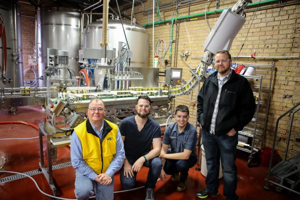 Joe Breker, Phillip Breker, Ryan Bandy and Chef Daniel Miles on a tour at Indeed Brewing Company