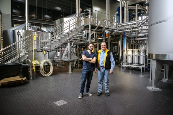 Phillip and Joe Breker standing in Surly's new German engineered brew house.